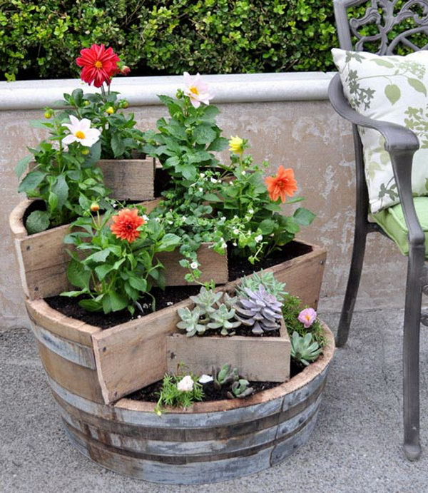 DIY recycled barrel garden pots. These container gardening ideas offer a great way to brighten your surroundings immediately. Make your home look different unique and interesting.