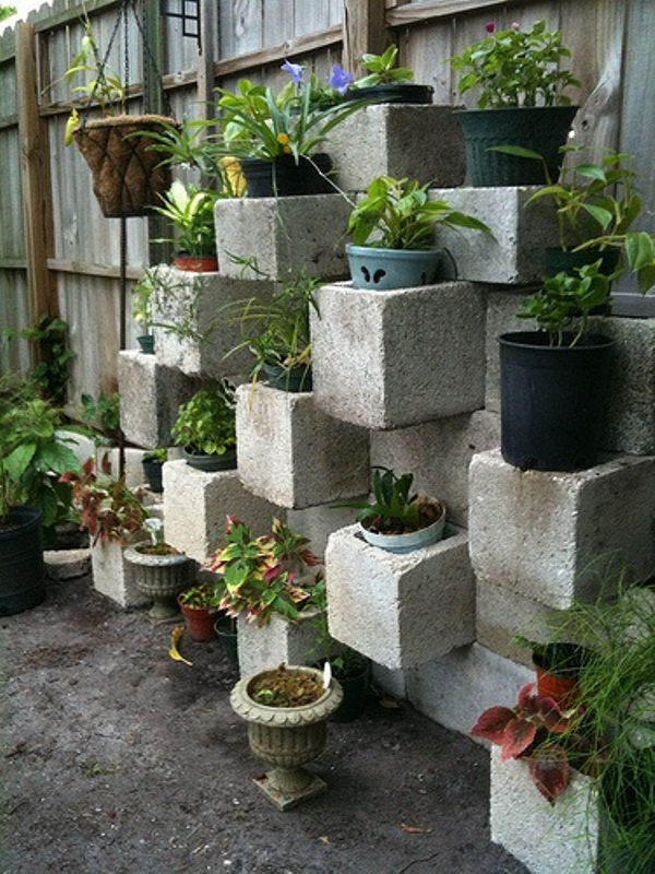 Cinder block focal point vertical planter. These container gardening ideas offer a great way to brighten your surroundings immediately. Make your home look different unique and interesting.