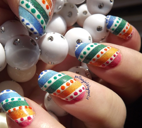 Cool Rainbow Nail Art. A beautiful and fun way to brighten up your everyday look or accessorize a special occasion outfit.