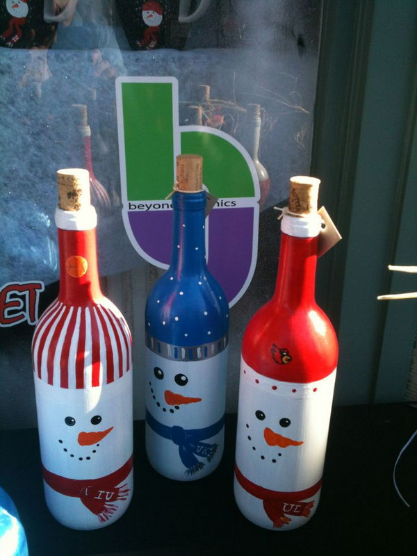 Snowman Painted Wine Bottles. Add charm to any Christmas tree or gift box, and make charming and thoughtful holiday presents for friends and family members.