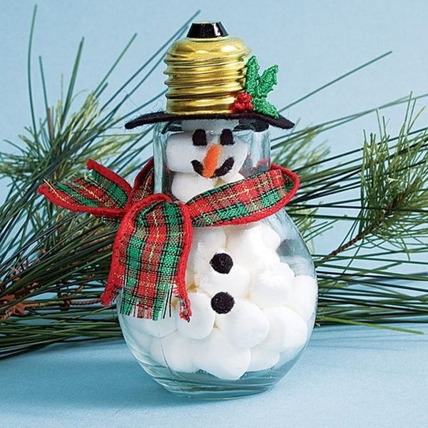 Recycled lightbulb snowman craft.