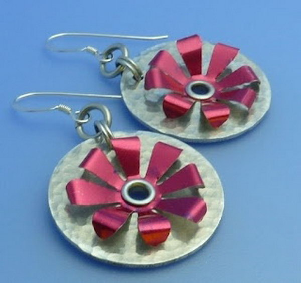 Recycled soda can earrings. After drinking soda from aluminum cans, you can recycle your soda cans to create interesting projects instead of tossing the empty cans into the garbage or recycling bin.