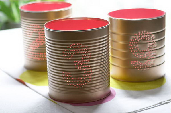 Tin can table numbers. Tin cans are not just for stacking up in your cabinet, tossing in the trash or sending to the recycle bin. Combine those with a rope, paints, craft papers and a generous helping of crazy imagination, and you will have a cool creation on your hands.
