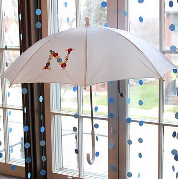 DIY craft using umbrella and buttons.
