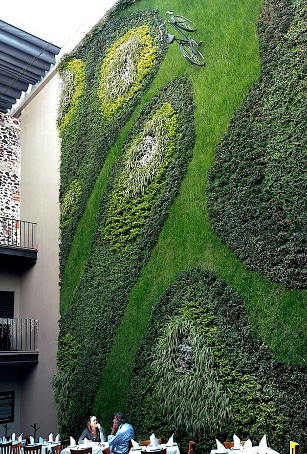 Gravity defying bike path. It allows plants to extend upward rather than grow along the surface of the garden. Doesn't take a lot of space and look so beautiful at the same time.