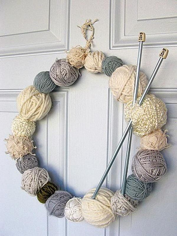Yarn wreath featuring wintry cream tones.