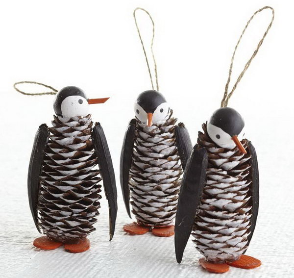 Pinecone penguin with a wooden ball for the head, bamboo skewer for the beak and pine cone body,