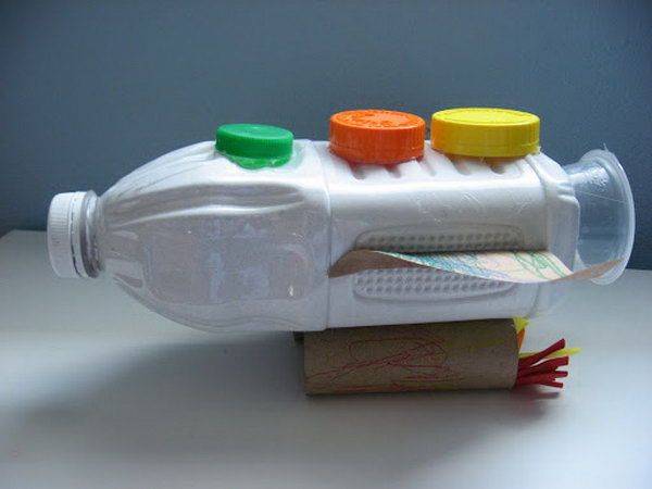 Recycled rocket craft made from juice bottle, toilet paper rolls and bottle caps.