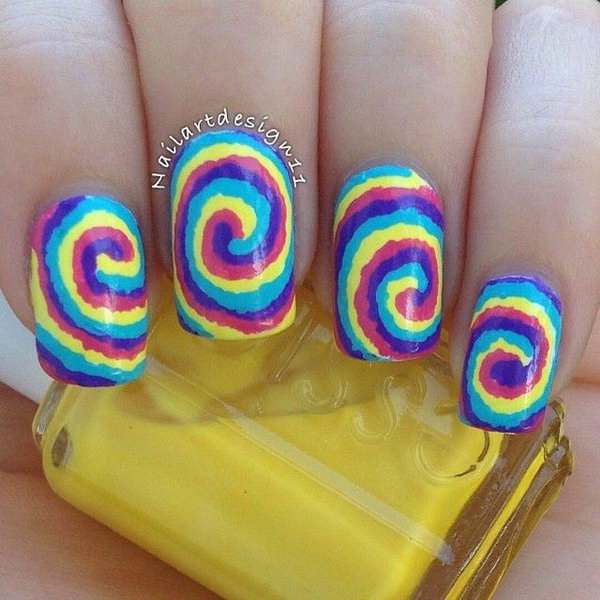 Cute And Creative Swirl Nail Art. Created using a technique called water marbling. It involves swirling together different colored nail polishes on nails.