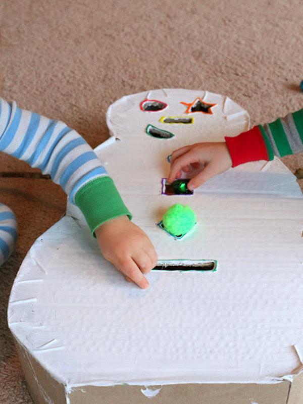 Use a cardboard box to create a snowman drop box for kids.