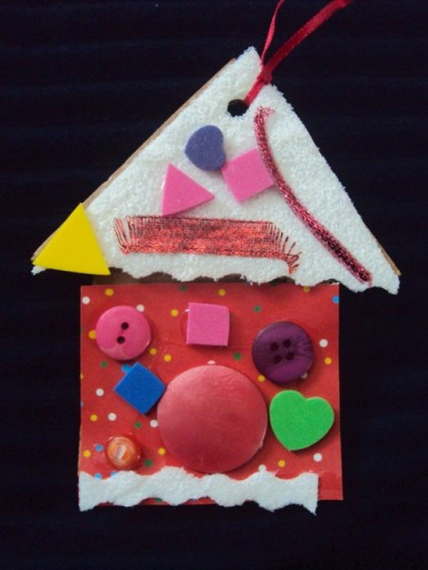 Cut a house shape from cardboard and cover with colourful paper or fabric for a Christmas ornament.