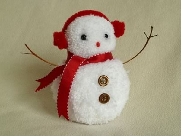 Create pom poms for the base, then decorate the snowman with beads, buttons, felt or ribbon,