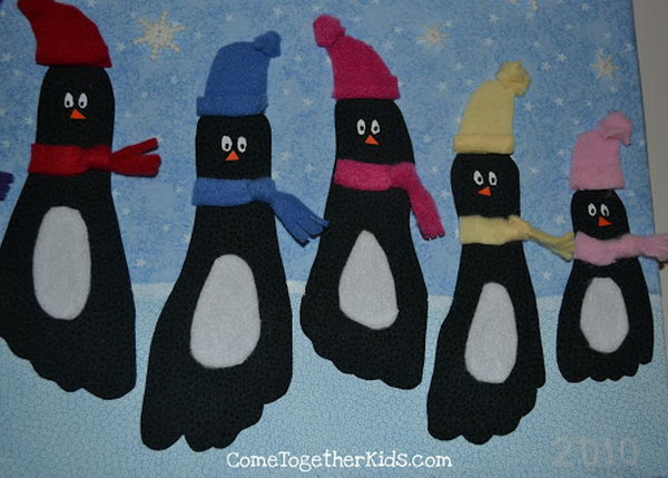 These penguin wall hangings is a really cute way to use footprints to create some winter art,