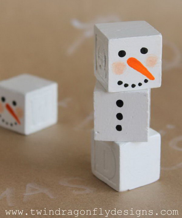 Paint these alphabet blocks to create snowman. add a scarf with a bit of scrap fabric, add a little top hat or toque, add stick arms with a bit of hot glue.