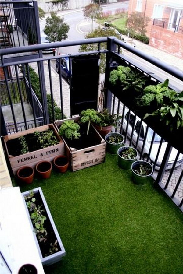 Small balcony on top floor flat which was covered with beautiful soft fake grass and planted salads and scented flowers in old fruit crates.