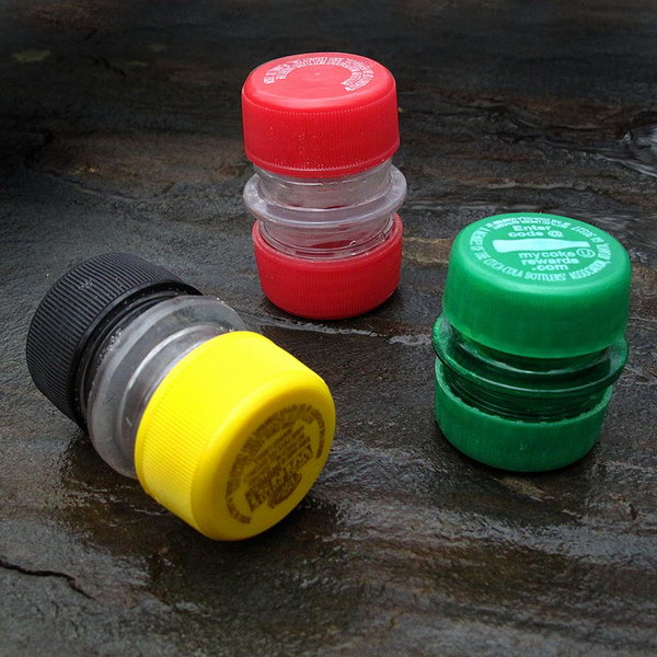 A small, lightweight reusable container made out of the necks and lids of two plastic soda bottles.