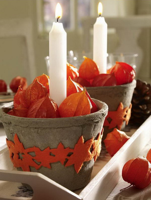 The idea of placing candles in small terra cotta pots is charming and effective.