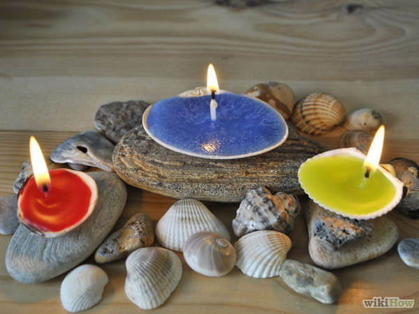 The shells that the ocean cast at your feet this summer make lovely remembrances of the season with candles formed inside them.