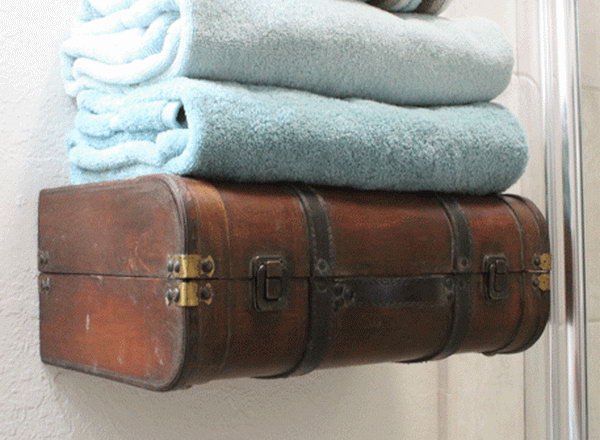 The bathroom towel shelf is lovely and the storage is brilliant. http://hative.com/creative-diy-ideas-with-old-suitcase/