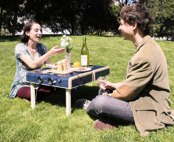 Suitcase repurposed into portable picnic table, with legs that fold inside. http://hative.com/creative-diy-ideas-with-old-suitcase/