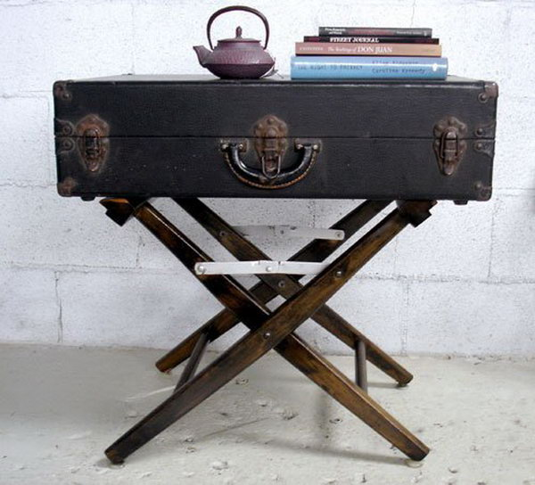 DIY side table made from a damaged canvas folding chair and a vintage suitcase.