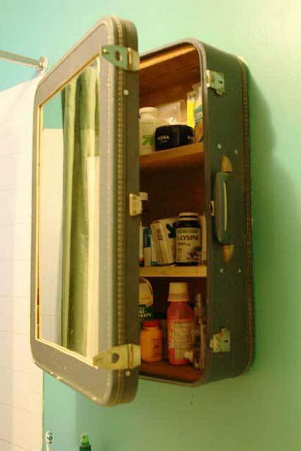 Upcycling an old suitcase into a medicine cabinet. Blake cut the front out of the suitcase and inserted a mirror and then created shelves and reinforced the inside with salvaged wood. http://hative.com/creative-diy-ideas-with-old-suitcase/