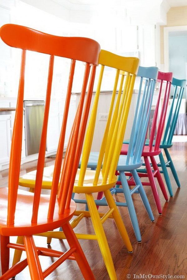 Spray painting these chairs with different colors. The kitchen is now infused with a happy, fresh, and positive vibe.