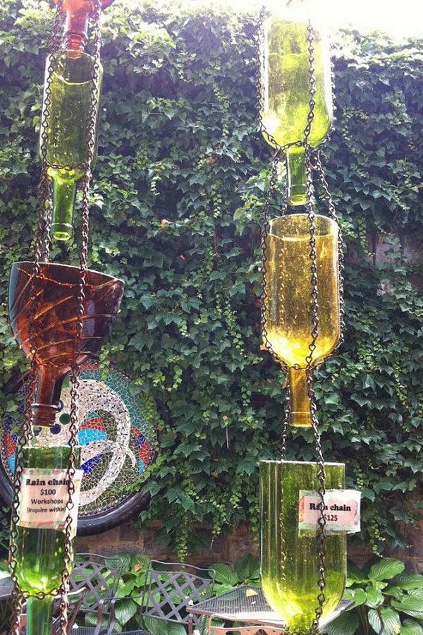 Up Cycled Wine Bottle Rain Chain. Not only make a good sound and enhance your house exterior appearance, but also divert water away from your house.
