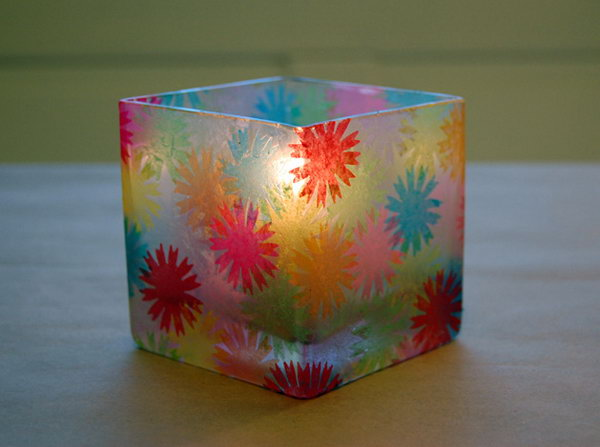 Use these colorful tissue paper to decorate a glass container and make a votive holder.