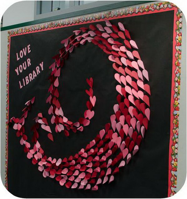 This Valentine's Day bulletin board with gorgeous three-dimensional swirling hearts design was created by talented library media specialist, Kristen.