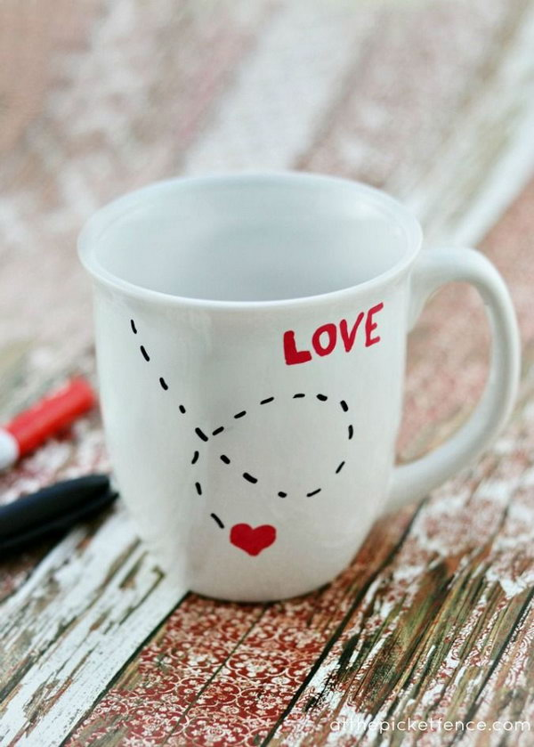 You can easily make this love mug yourself! All you need is an inexpensive mug, paint pens and an oven! http://hative.com/cute-valentines-day-ideas/
