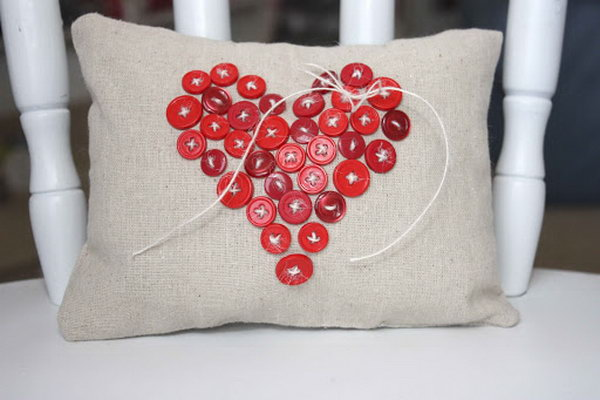 Decorate your pillow with a button heart shape. http://hative.com/cute-valentines-day-ideas/