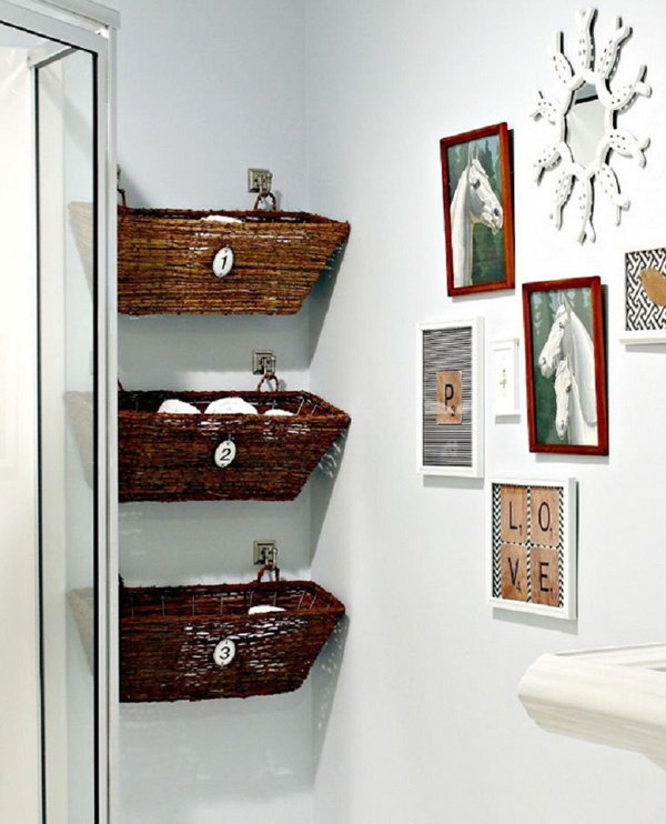 This idea of hanging baskets on the wall is a great solution that doesn't take up any floor space in a bathroom with a small footprint.