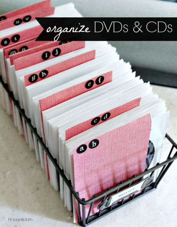 Reduce storage space by using the CD and DVD Sleeves. Make alphabet dividers out of sturdy scrapbook paper and stickers. It makes finding a movie simpler.