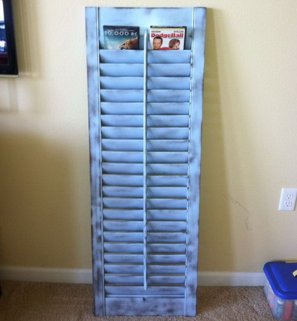 This Old Shutter Was Painted And Repurposed To Be A DVD Holder.