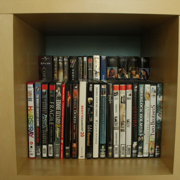 Amazing Double DVD Storage Space By Placing A Raised Shelf In The Back Of A  Bookcase.