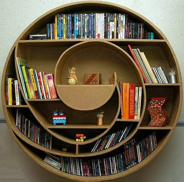 This Circular Cardboard Shelf Not Only Provides Space For Your Movie DVDS  And Books, But