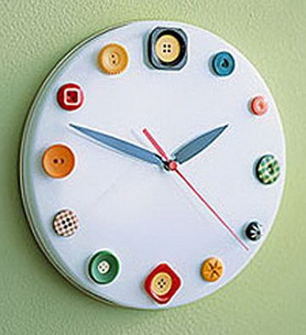 button clock made out of a cookie tin lid buttons and clock parts