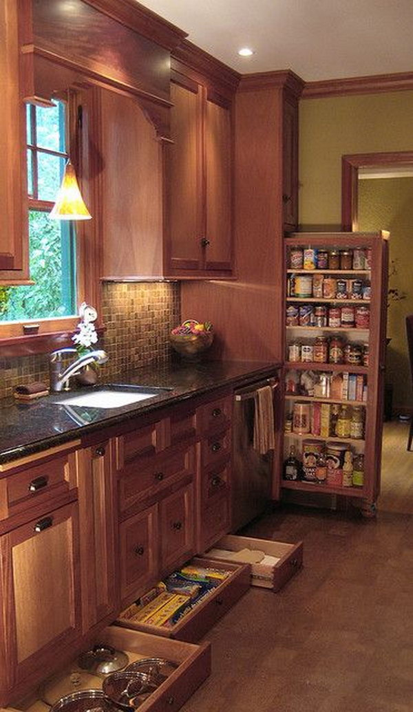 Narrow drawers underneath the cabinetry provide storage for narrow ...