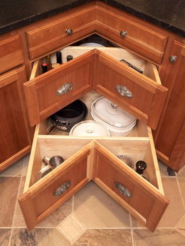 Instead of having the long dark cave of a cabinet, the corner sliding drawers make better use of your counter corners.