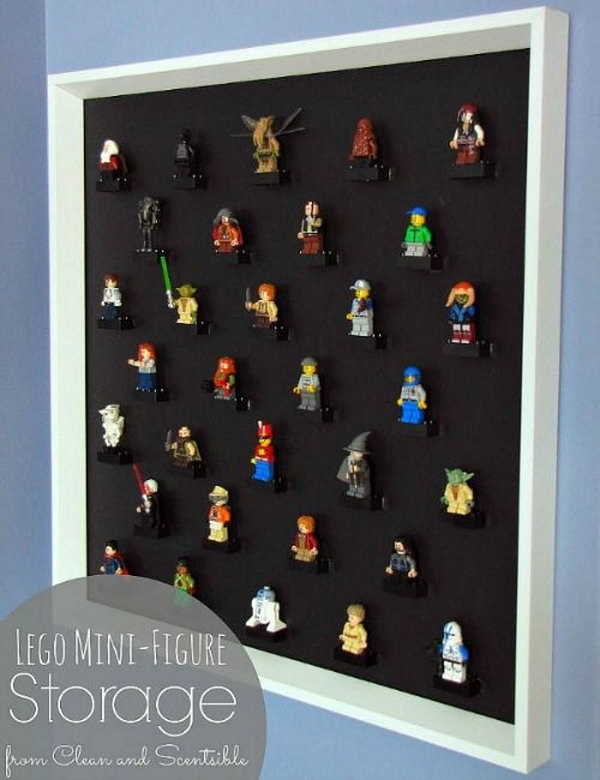 Turn a large picture frame with the glass removed into a DIY Lego Mini-figure display.