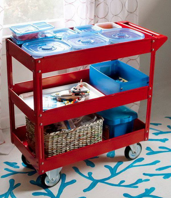 Use a three shelf steel service cart to store the Lego sets and characters as well as projects in progress. Kids are free to work on the dining room table, the kitchen table, the coffee table — wherever the family is congregating.