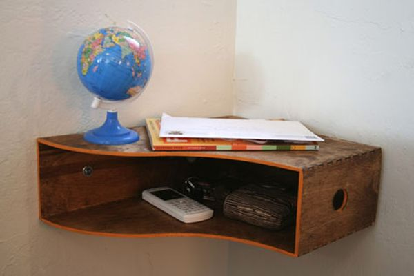 This wooden magazine holder from ikea turned out to be the perfect catch all shelf for little items like keys, accessories and bills. All you had to do was put a coat of stain on it, turn it on its side and mount it in the corner of our entryway.