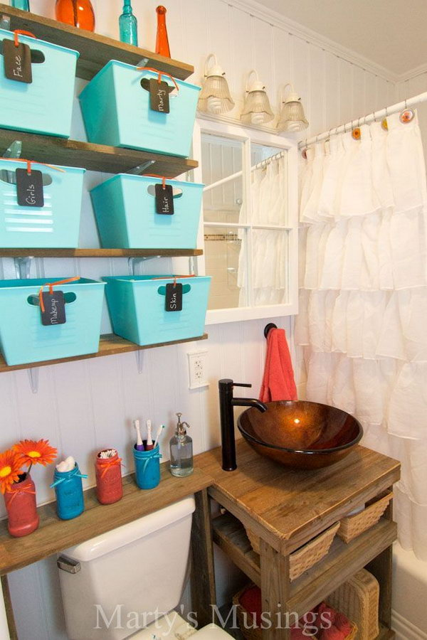 Extend space over the toilet for more storage with the fence board shelves and dollar store baskets.