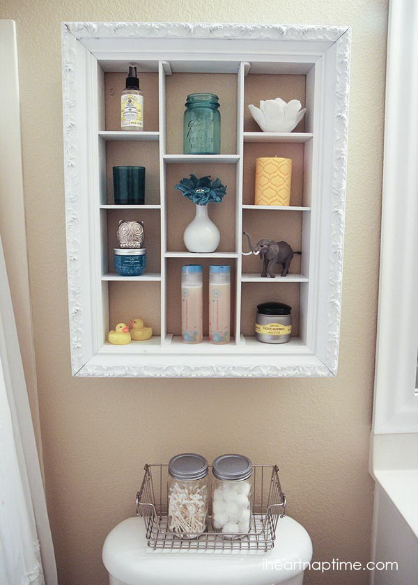 Repurpose an old picture frame into an over the toilet storage unit.
