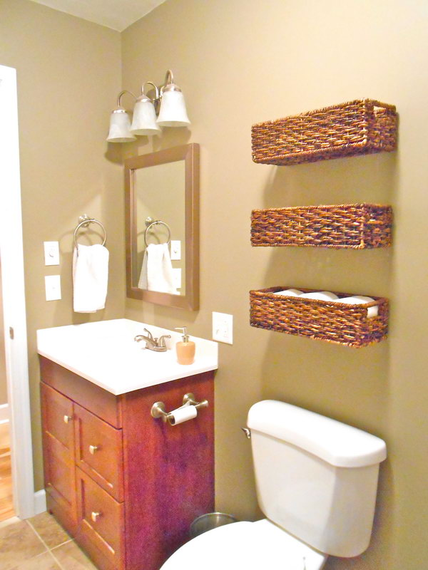 Use the baskets over the toilet to store band-aids, extra toilet paper and other first aid stuff. These baskets are not only lovely, but also functional.