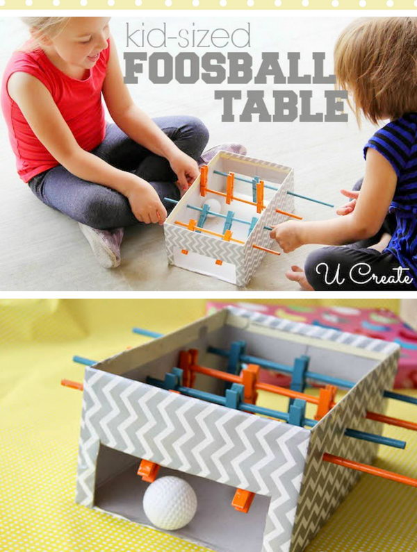 DIY Mini foosball table made with shoebox, clothespins and small wooden dowels.