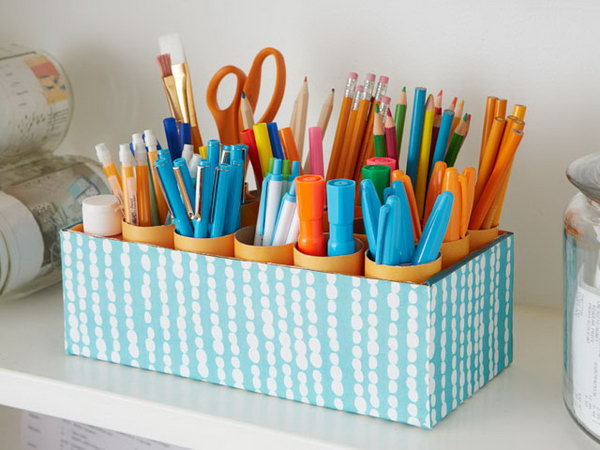 What a cool organization idea to make a DIY shoe box desk caddy for holding writing implements as well as brushes, scissors and other craft supplies.