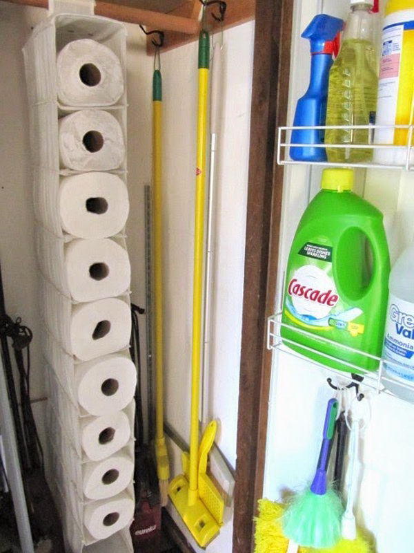 Use a hanging shoe organizer to hold the unused paper towels.