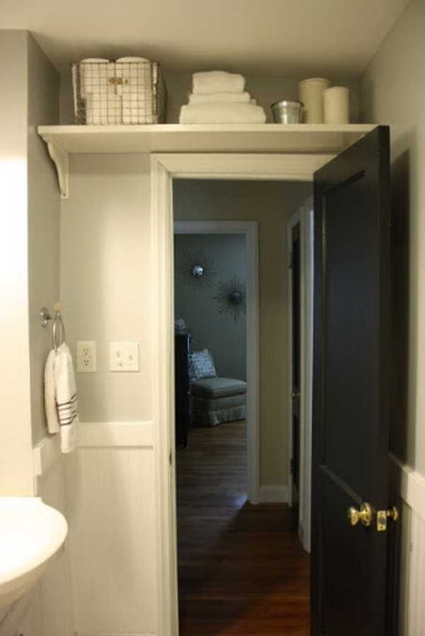 Store bathroom extras like toilet paper and extra towels with the shelf above the door. Clever Toilet Paper Storage or Holder Ideas   Hative
